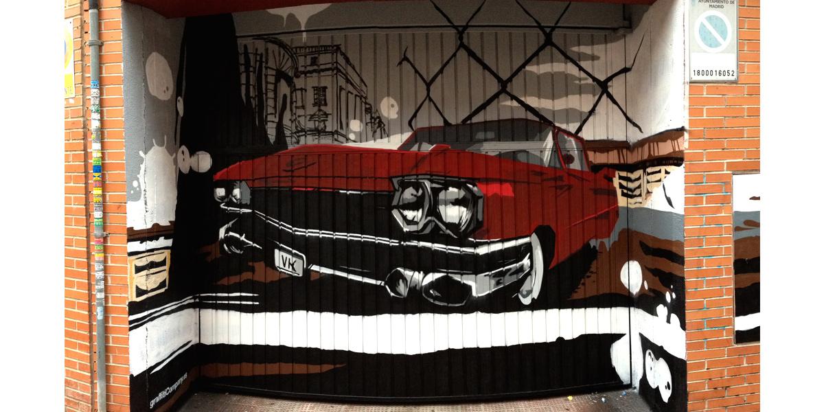 Graffiti de coche en garaje de Madrid