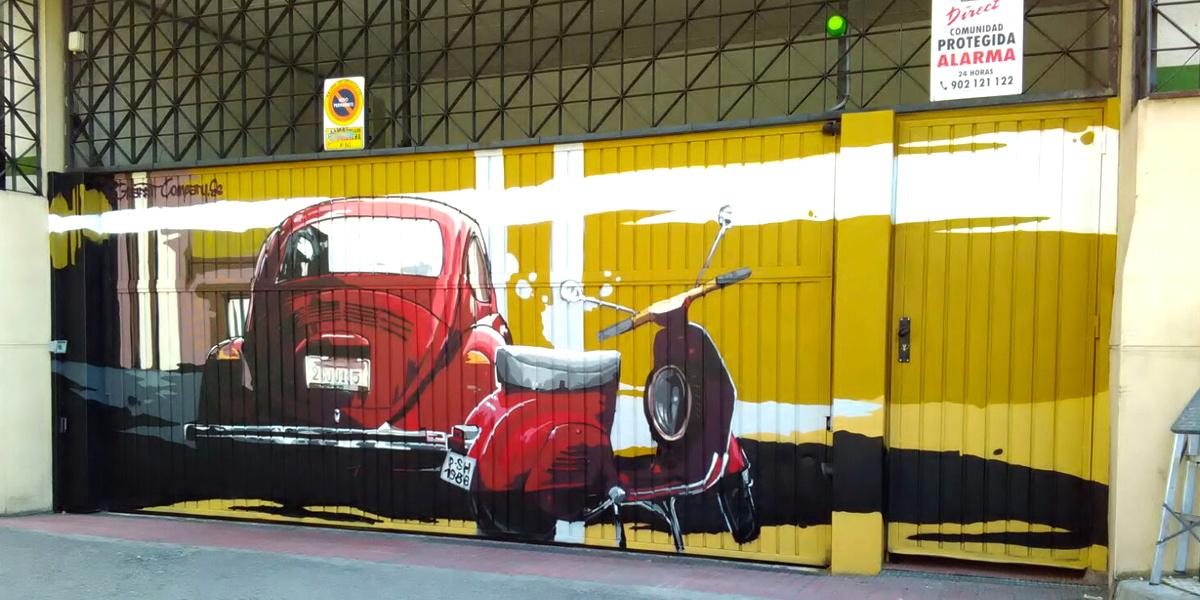 Graffiti de 600 y Vespa en puerta de garaje en Madrid