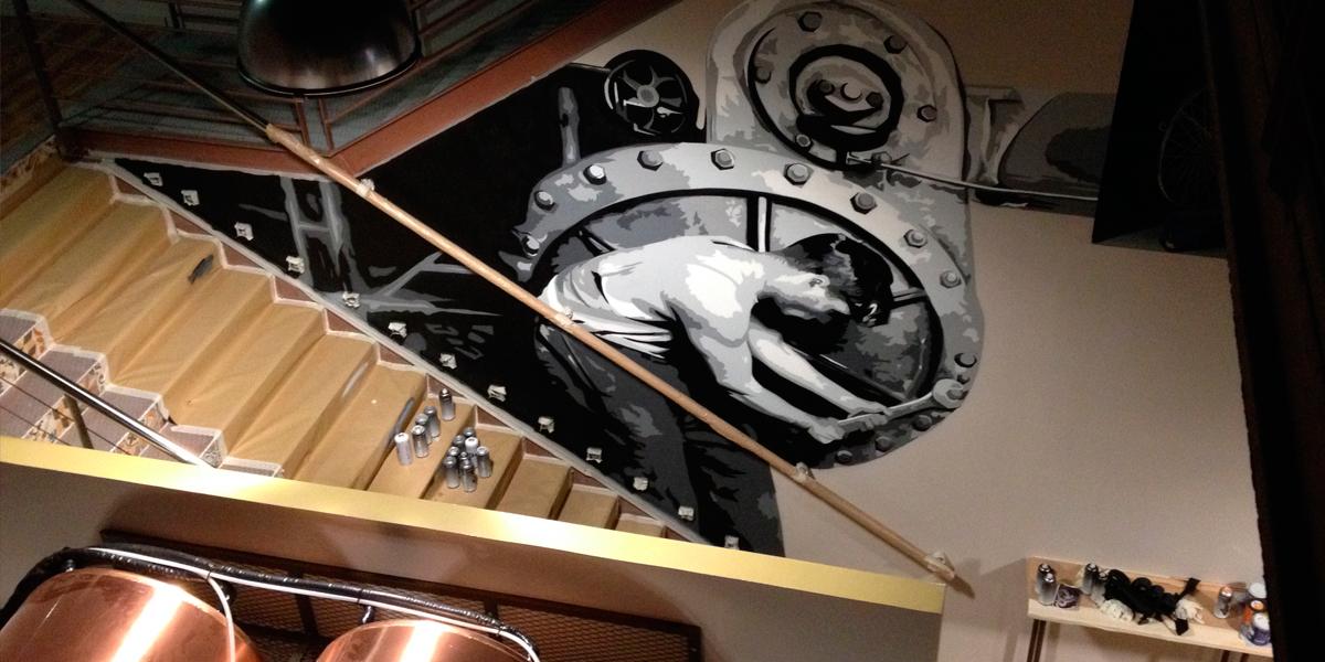 Graffiti por encargo realizado en escaleras de bar de Madrid