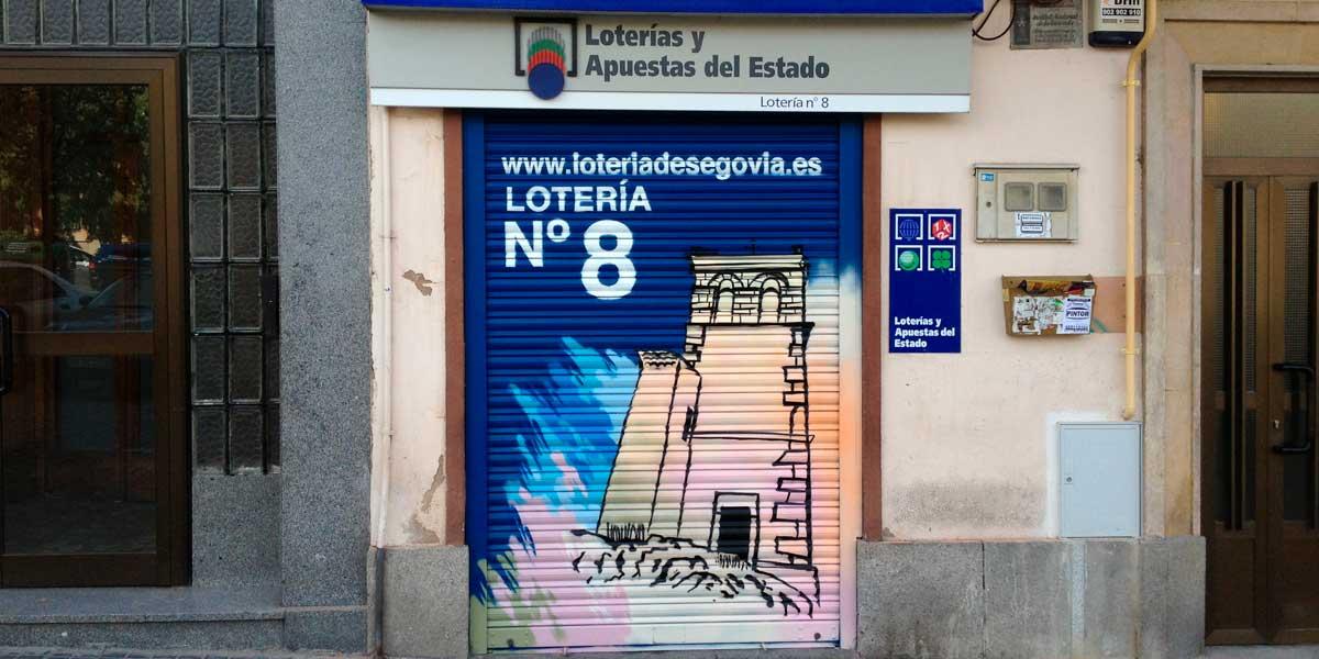 Graffiti en cierre de loterías de Segovia.