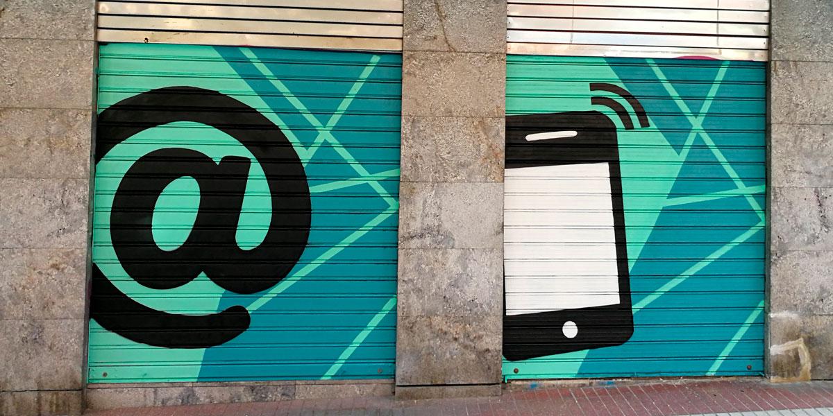 Graffiti de móvil en cierre de Madrid.
