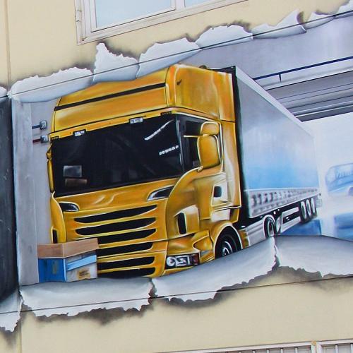 Graffiti realista de camión en Madrid
