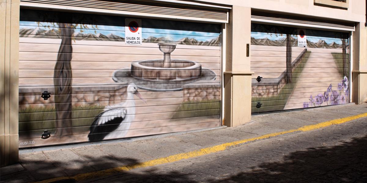 Graffiti de paisaje y cigüeña en Segovia