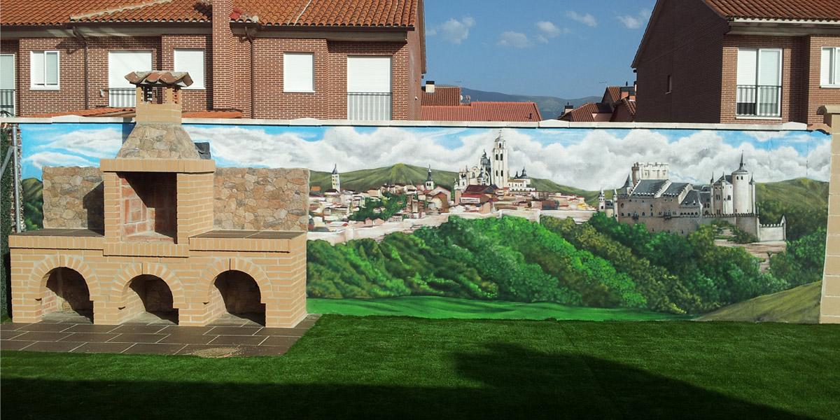 Graffiti con paisaje de Segovia en jardín.