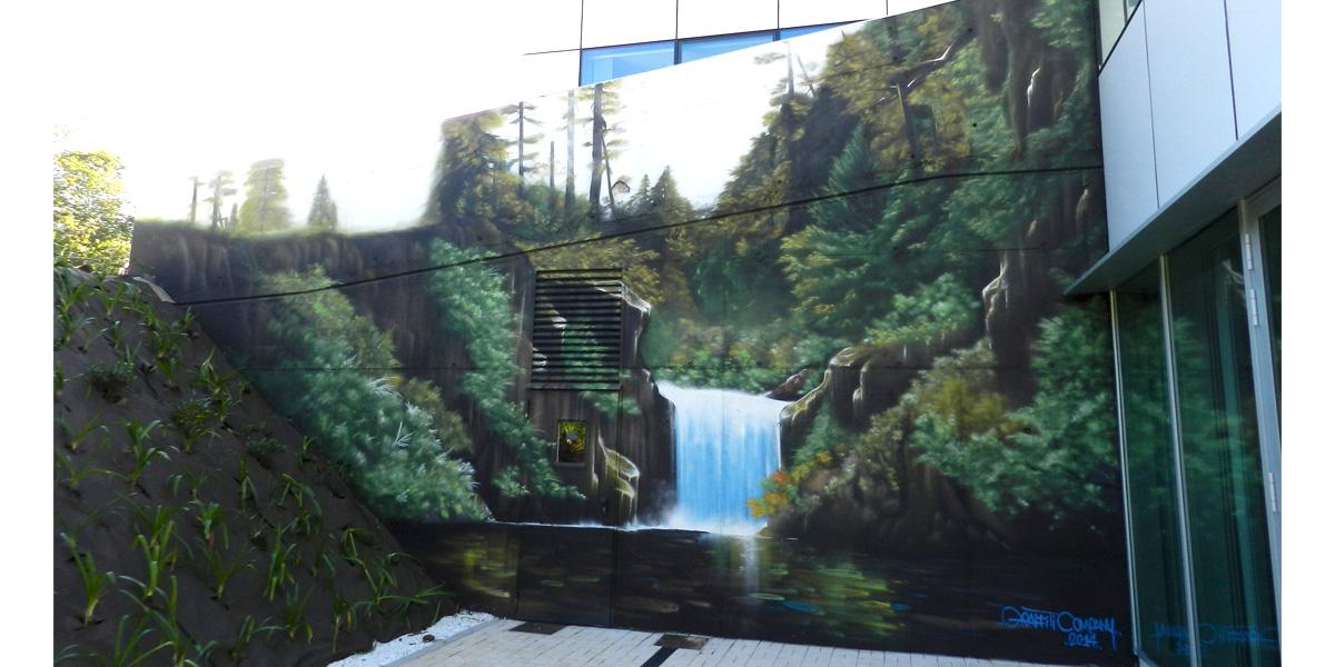 Mural de paisaje de cascada en Gijón
