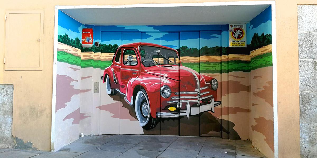 Puera de garaje de Valladolid con graffiti.