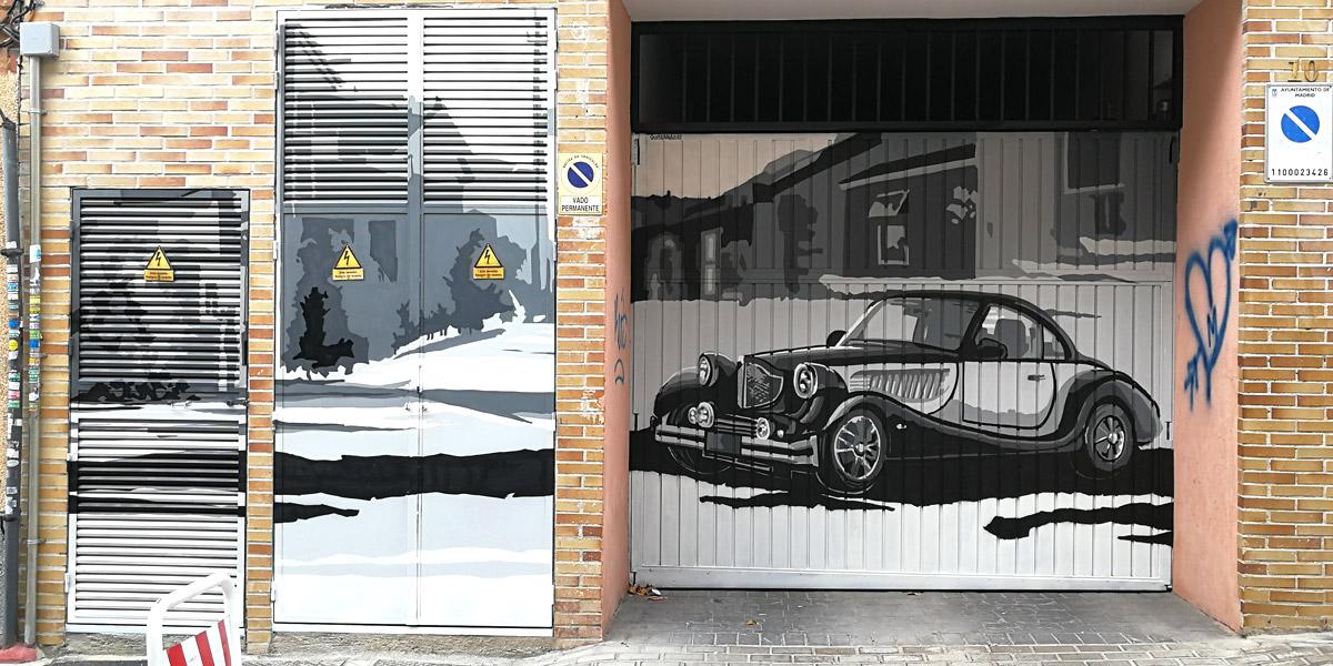 Grafiti de coche clásico en Madrid.