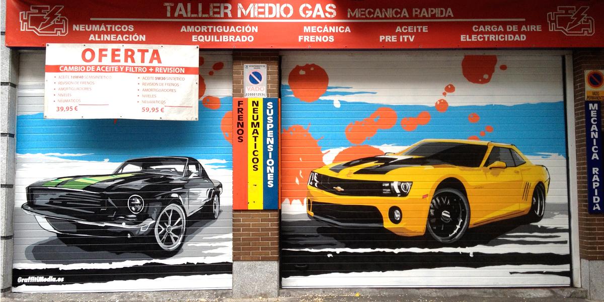 Graffiti de coches en taller mecánico de Madrid