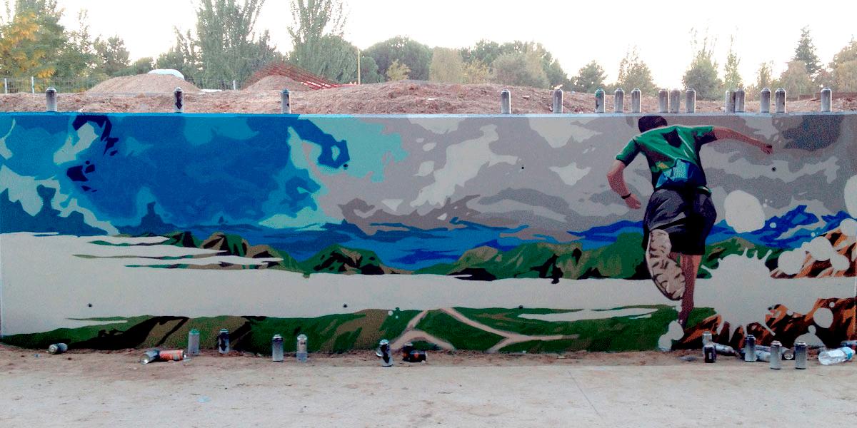Graffiti profesional de runner en Madrid Río.